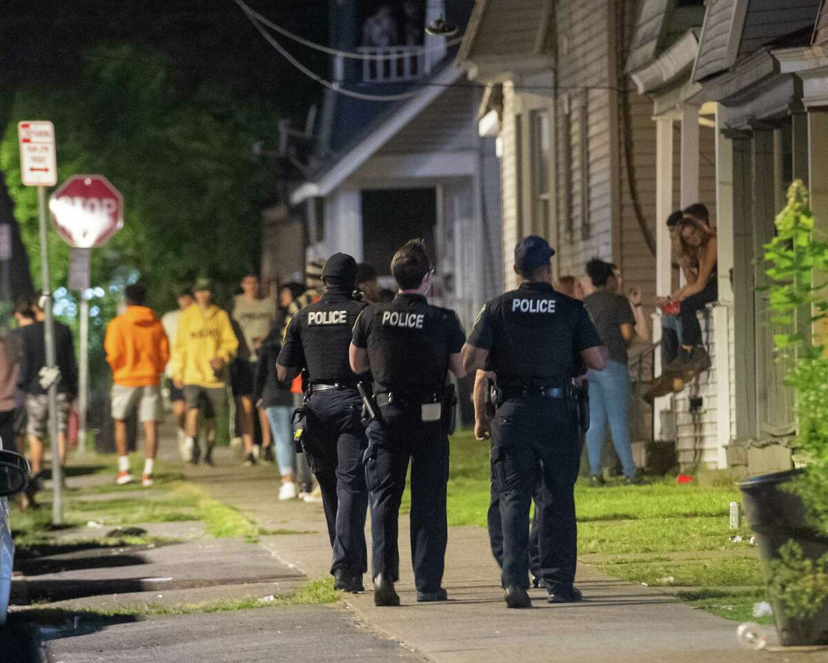 Albany police officers walk along Hudson Avenue in Albany, NY, where UAlbany students had a number of house parties on Friday, Aug. 28, 2020 (Jim Franco/special to the Times Union.)