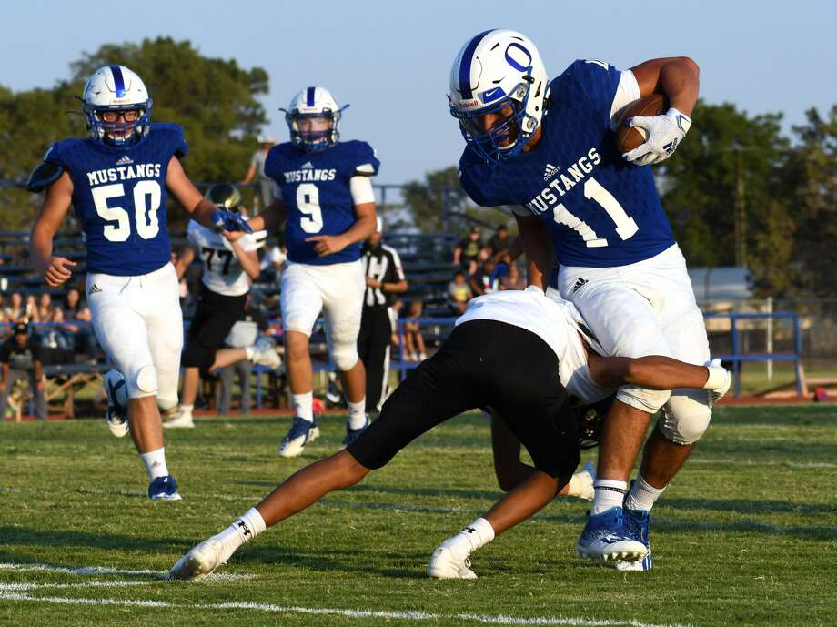 Olton's Aldo Vasquez skates past a Sudan defender while teammates Grady Roberts (50) and Logan Lassiter look on on his way to a touchdown during their high school football game on Aug. 28, 2020 at Olton. Photo: Nathan Giese/Planview Herald