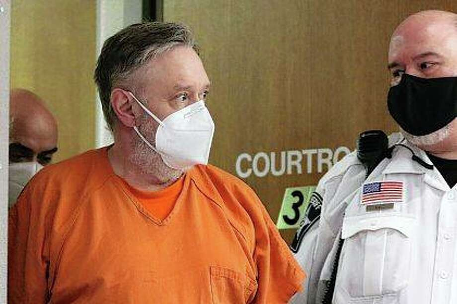 Andrew Freund Sr. is led into court Friday for a trial status appearance at Michael J. Sullivan Judicial Center in Woodstock. Freund is accused of multiple charges in the April 2019 death of his son, A.J. Freund, 5. Photo: Matthew Apgar | Northwest Herald Via AP