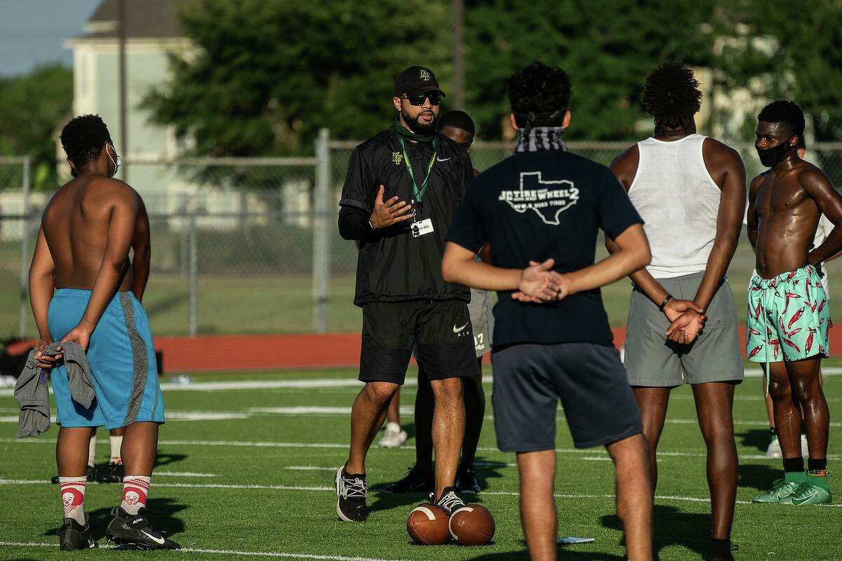Klein Forest head football coach Johnathan Wilson and student athletes participate in summer strength and conditioning camp with safety measures in place amid the COVID-19 pandemic.