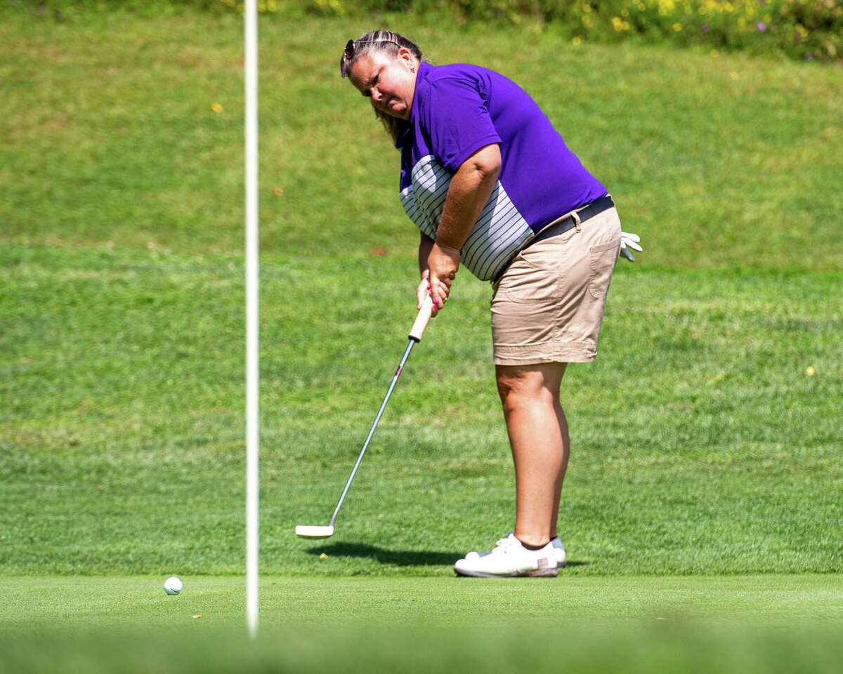 Colleen Cashman-McSween, the UAlbany golf coach, hits a putt during the CDPHP Pro-Am featuring Symetra Tour players at Capital Hills Golf Course in Albany, NY, on Friday, Aug. 28, 2020 (Jim Franco/Special to the Times Union.)