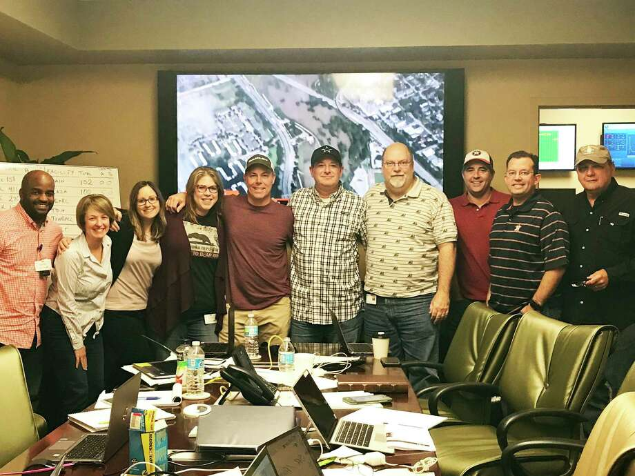 In this photo taken before the pandemic, the HCA Houston Healthcare Command Center celebrates after Hurricane Harvey where their hospitals continuously provided care to 2,900 patients throughout the storm. Zero patients harmed. With their Division Emergency Operations Center concept, they are prepared to support their facilities during any emergency situation. Photo: Submitted