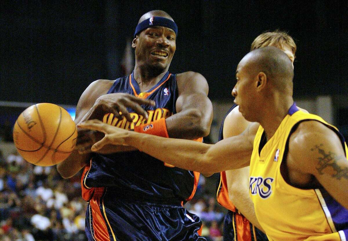 Golden State Warriors forward Cliff Robinson, left, has the ball stripped by Los Angeles Lakers' Caron Butler in the first quarter during a preseason game Sunday, Oct. 17, 2004, in Bakersfield, Calif. (AP Photo/The Bakersfield Californian, Alex Horvath) ** MANDATORY CREDIT ** Ran on: 10-18-2004 The Warriors Cliff Robinson loses the ball to Caron Butler in Sundays preseason game in Bakersfield.