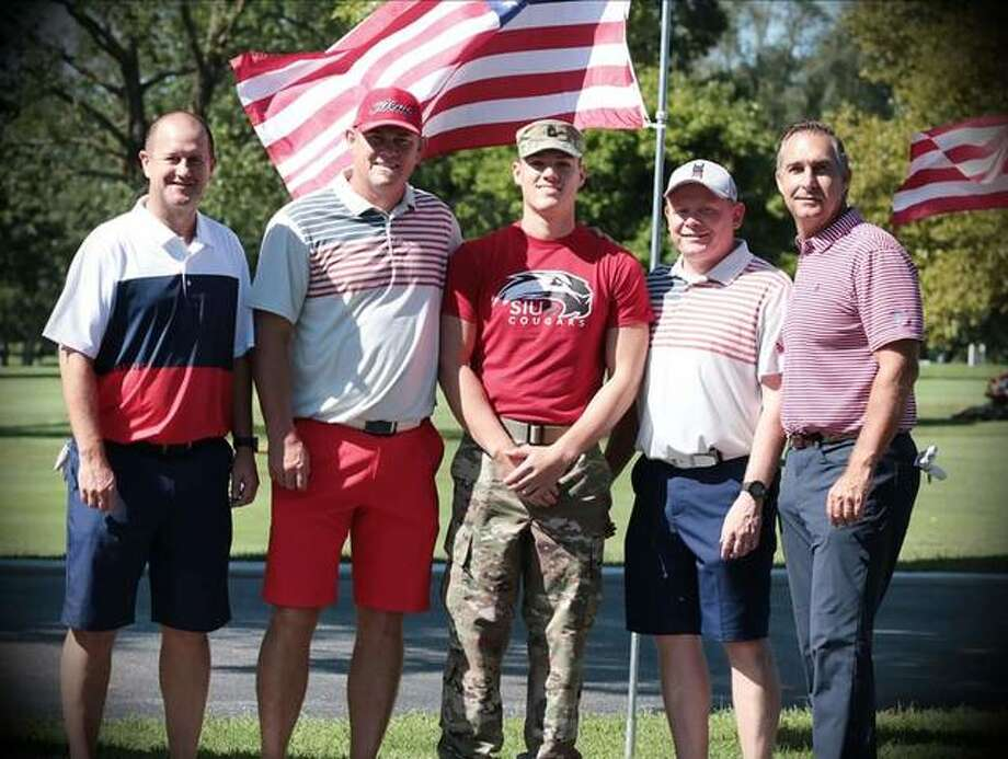 Golfers Jason Geminn, left; Jason Isringhausen, second from left; Cory Darr, second from right; John Mozeliak, right; pose with a member of the SIUE ROTC Color Guard during last year's Volition America Five-Star Golf Challenge at Sunset Hills Country Club. Isringhausen is a former pitcher for the St. Louis Cardinals and Mozeliak is the Cardinals' director of baseball operations. Photo: For The Intelligencer