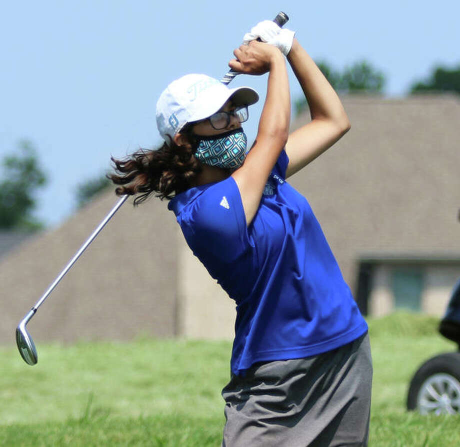 Marquette Catholic sophomore, shown shooting for the green Tuesday at the Metro East Shootout at Far Oaks in Caseyville, recorded her first hole-in-one on Aug. 18 at the Madison County Tournament at The Legacy in Granite City. Photo: Greg Shashack / The Telegraph
