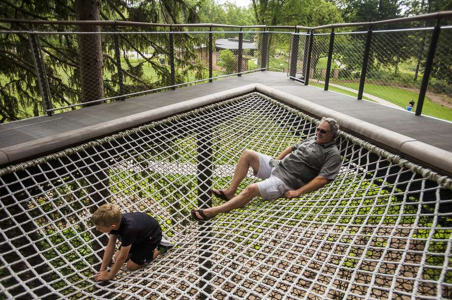 Rick Gerard of Bay City, right, explores the Whiting Forest Canopy Walk with his grandson, Wyatt Wackerle, 7, Thursday, Aug. 27, 2020 in Midland. (Katy Kildee/kkildee@mdn.net) Photo: (Katy Kildee/kkildee@mdn.net)