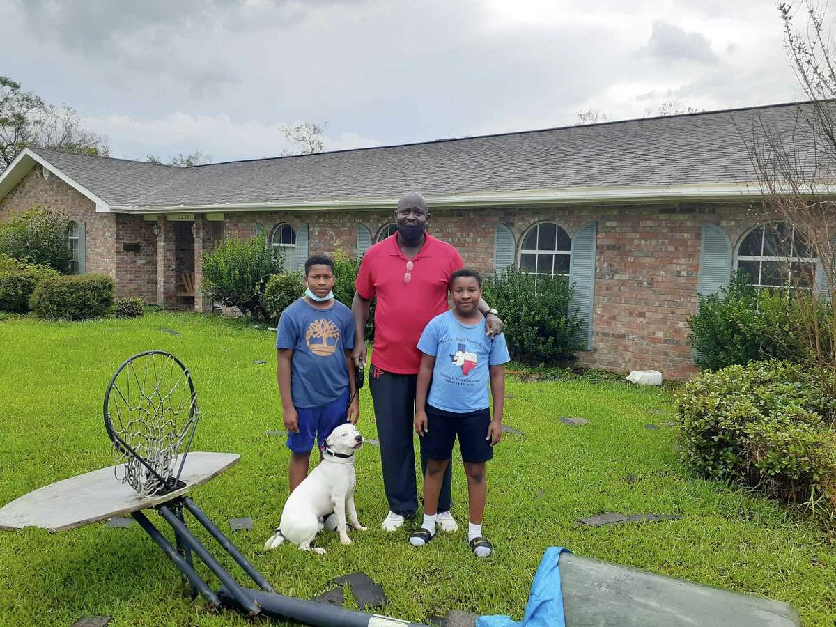 David Miller (center), a single father, with his sons, David III, 13, and William, 10, returned home to Lake Charles on Friday not knowing what to expect. Before they left they walked every inch of the house and prayed it would survive Hurricane Laura.