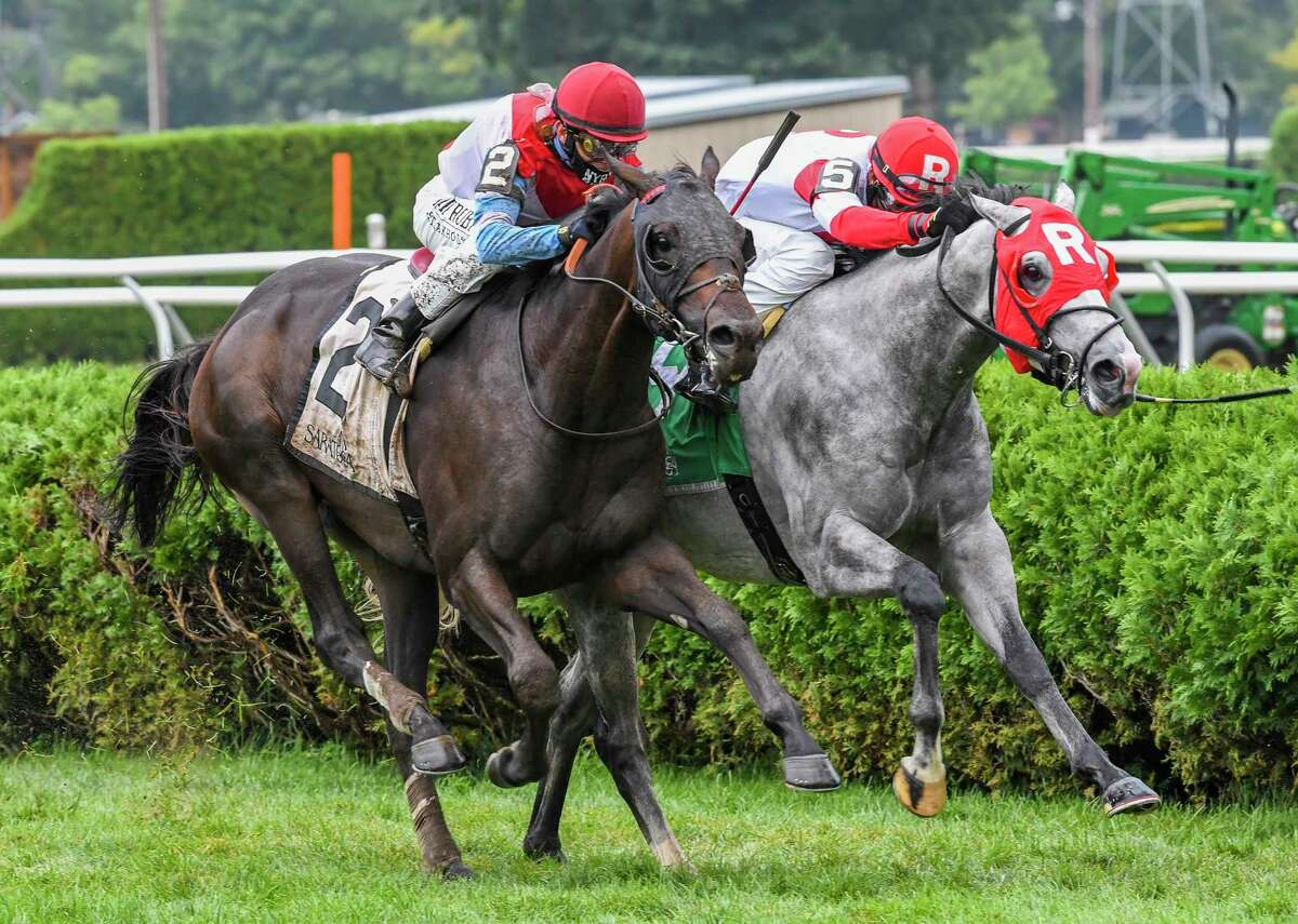 Bye Bye Melvin with jockey John Velazquez comes up on the outside of Don Juan Kitten with Kendrick Carmouche aboard to win the 113th running of The Saranac Saturday Aug.29, 2020 at the Saratoga Race Course in Saratoga Springs, N.Y. Photo by Skip Dickstein/Special to the Times Union