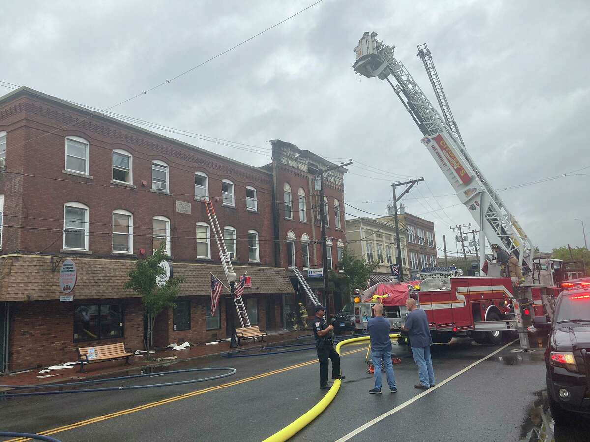 Firefighters at the scene of a fire on Main Street in Seymour Aug. 29, 2020.