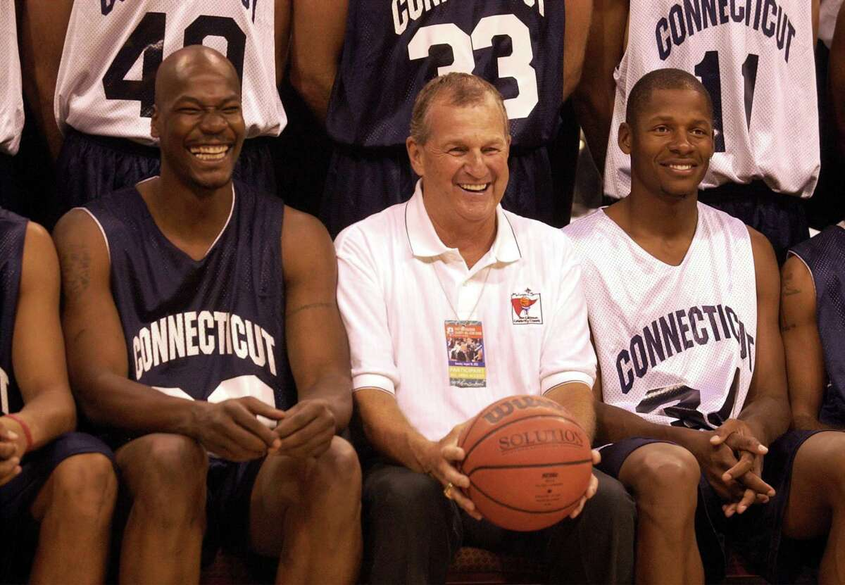 UConn alumnus Cliff Robinson, left, shares a laugh with coach Jim Calhoun, center and Ray Allen before a basketball game at the Mohegan Sun Casino's arena in Uncasville in 2002.