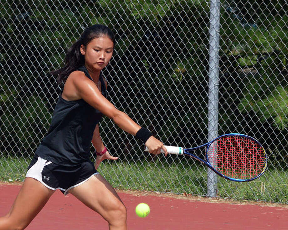 Edwardsville's Choe Koons reaches for a shot Saturday in the No. 1 doubles final at the EHS Doubles Invite. Photo: Scott Marion/The Intelligencer