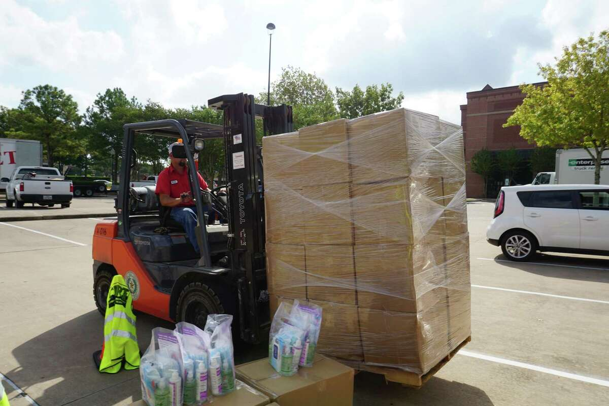 A forklift moves a pallet of personal protective equipment kits at a Fort Bend County distribution event outside Cinco Ranch Branch Library on Friday, Aug. 28.