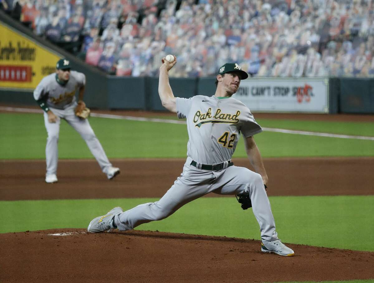 Oakland Athletics starting pitcher Chris Bassitt (42) pitches during the first inning of game one of a double header during an MLB baseball game at Minute Maid Park, Saturday, August 29, 2020, in Houston. All players for this game are wearing number 42 for Jackie Robinson Day.
