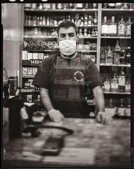 Rafik Hamdallah, 35. Cashier at Reno�s Liquor store. Saturday, May, 9, 2020. Dogpatch district, San Francisco, California. Photo: Gabrielle Lurie / The Chronicle