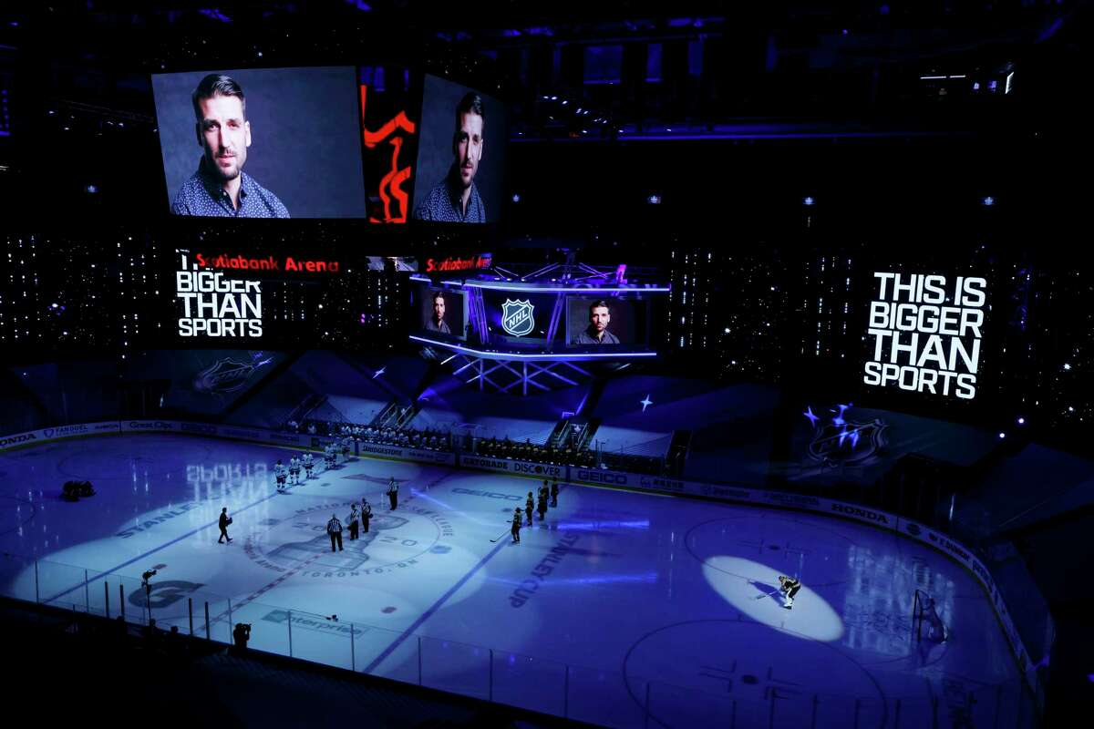 A video message about racism is played before an NHL hockey Stanley Cup playoff game between the Boston Bruins against the Tampa Bay Lightning in Toronto, Saturday, Aug. 29, 2020. (Cole Burston/The Canadian Press via AP)