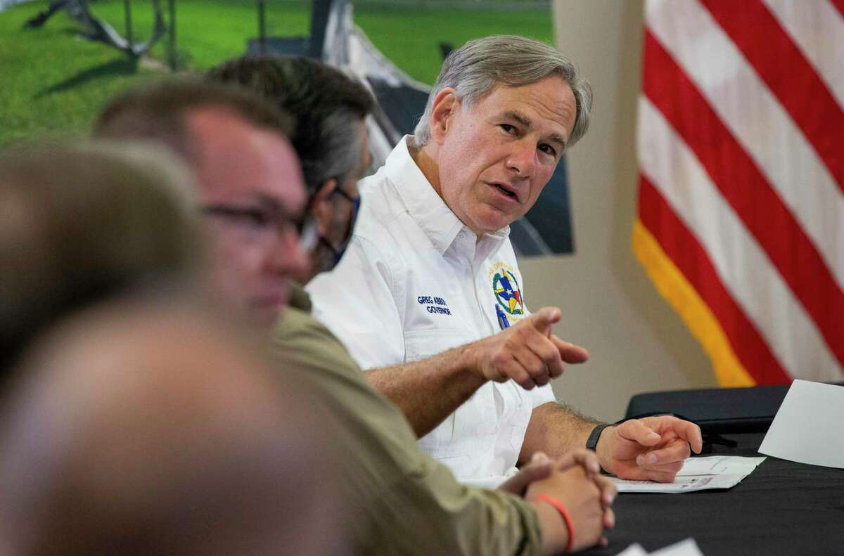 Gov. Greg Abbott gives a brief to President Donald J. Trump with the Hurricane Laura responses and damages from local and Texas officials Saturday, Aug. 29, 2020, at Orange County emergency center in Orange.