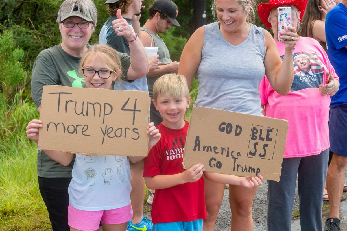 This family came out to express their support of the President. Texas and Orange County officials welcome President Trump on Saturday afternoon as hundreds lined Highway 87 outside the Orange County Airport to express their support. Photo made on August 29, 2020. Fran Ruchalski/The Enterprise