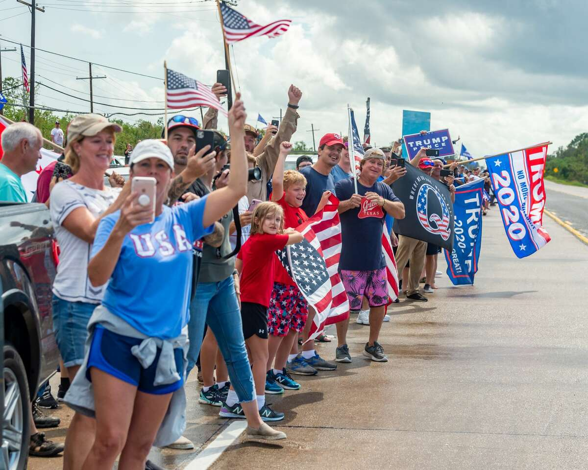 Texas and Orange County officials welcome President Trump on Saturday afternoon as hundreds lined Highway 87 outside the Orange County Airport to express their support. Photo made on August 29, 2020. Fran Ruchalski/The Enterprise