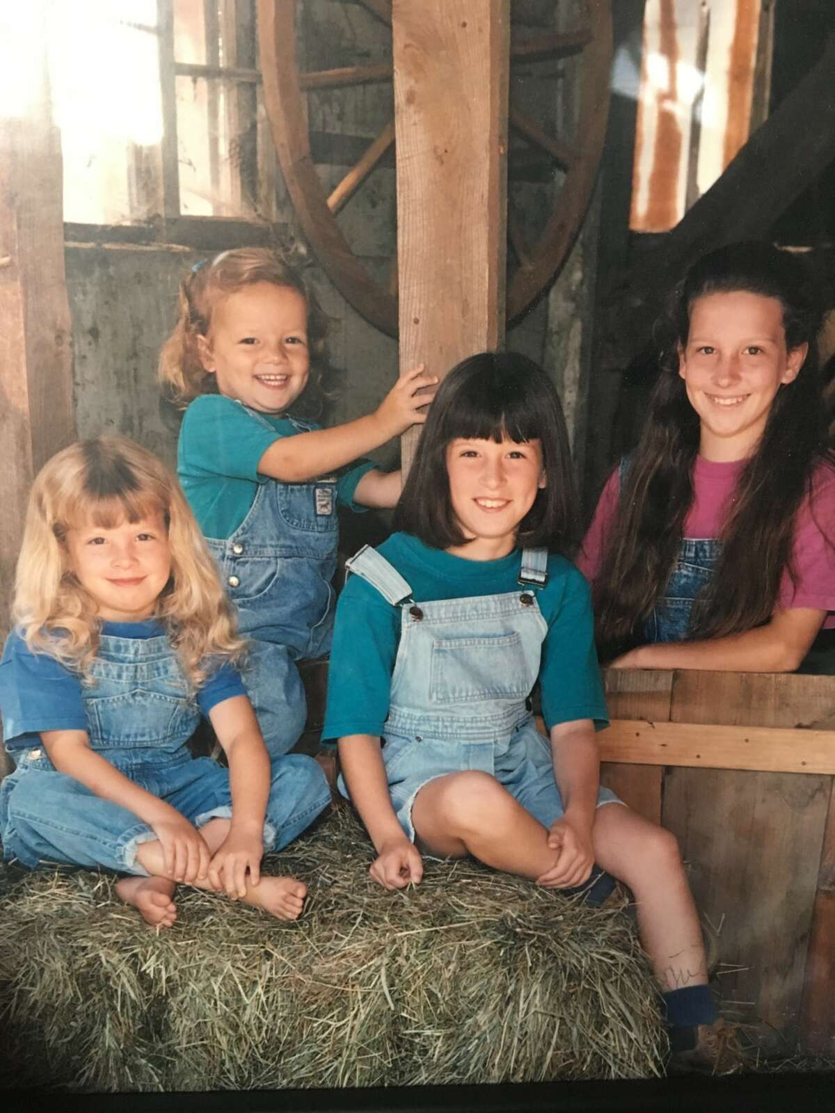 1. I am the second youngest of four sisters. And no, my parents weren't trying for a boy. My dad claims he only wanted daughters. We endured many themed photo shoots that Mom says I behaved terribly for, which really doesn't sound like me. (I'm on the far left).