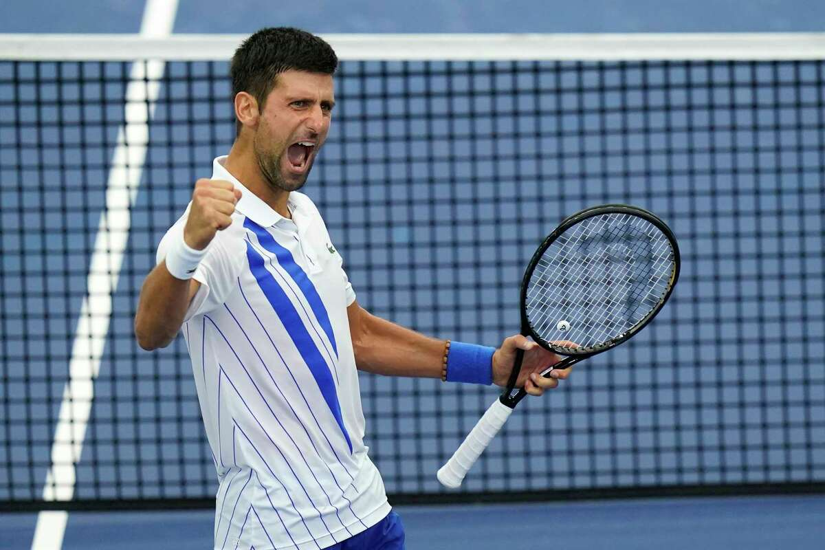 Novak Djokovic, of Serbia, reacts to winning his match with Milos Raonic, of Canada, during the finals of the Western & Southern Open tennis tournament Saturday, Aug. 29, 2020, in New York. (AP Photo/Frank Franklin II)