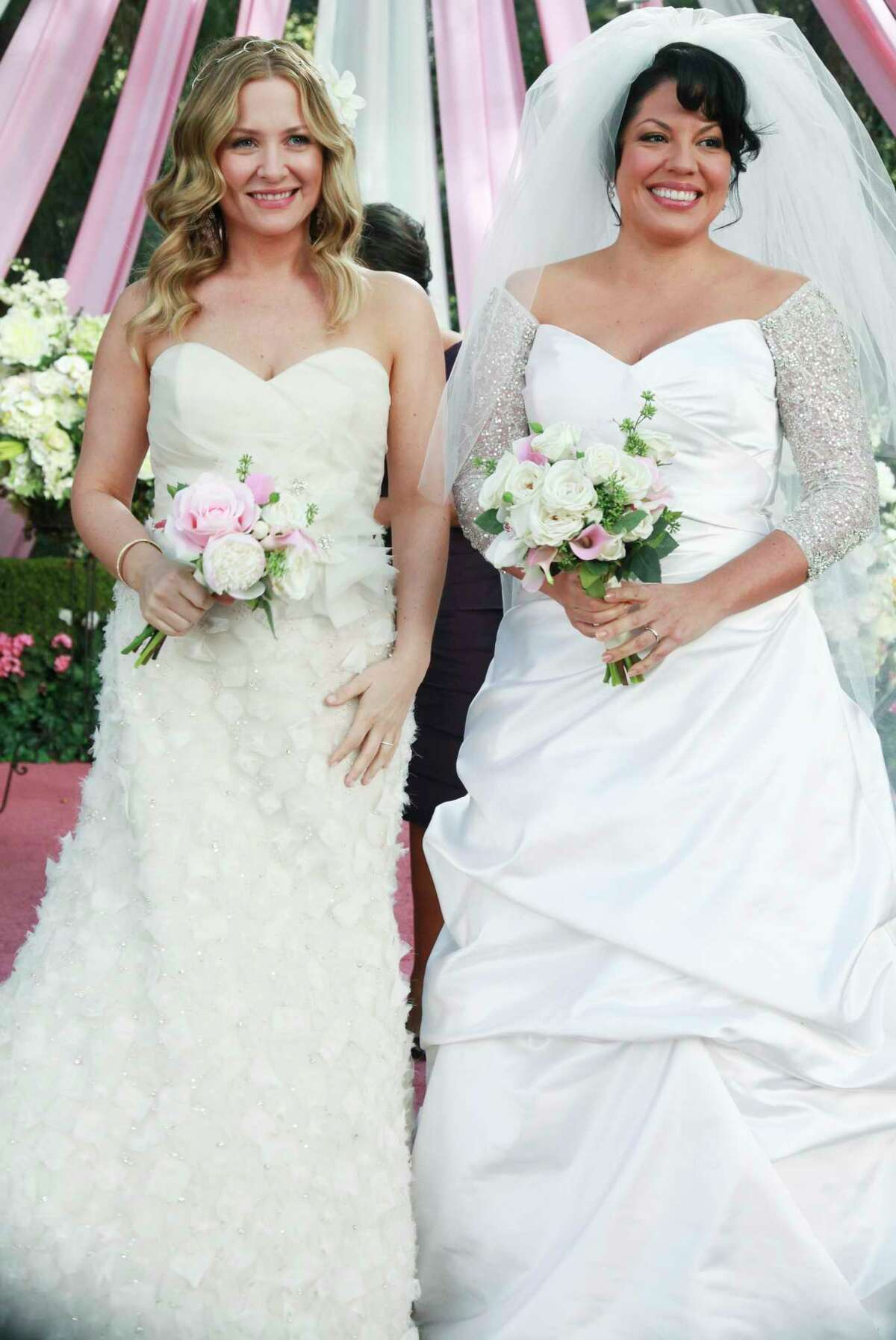 Jessica Capshaw, left, as Arizona and Sara Ramirez as Callie are married during an episode of