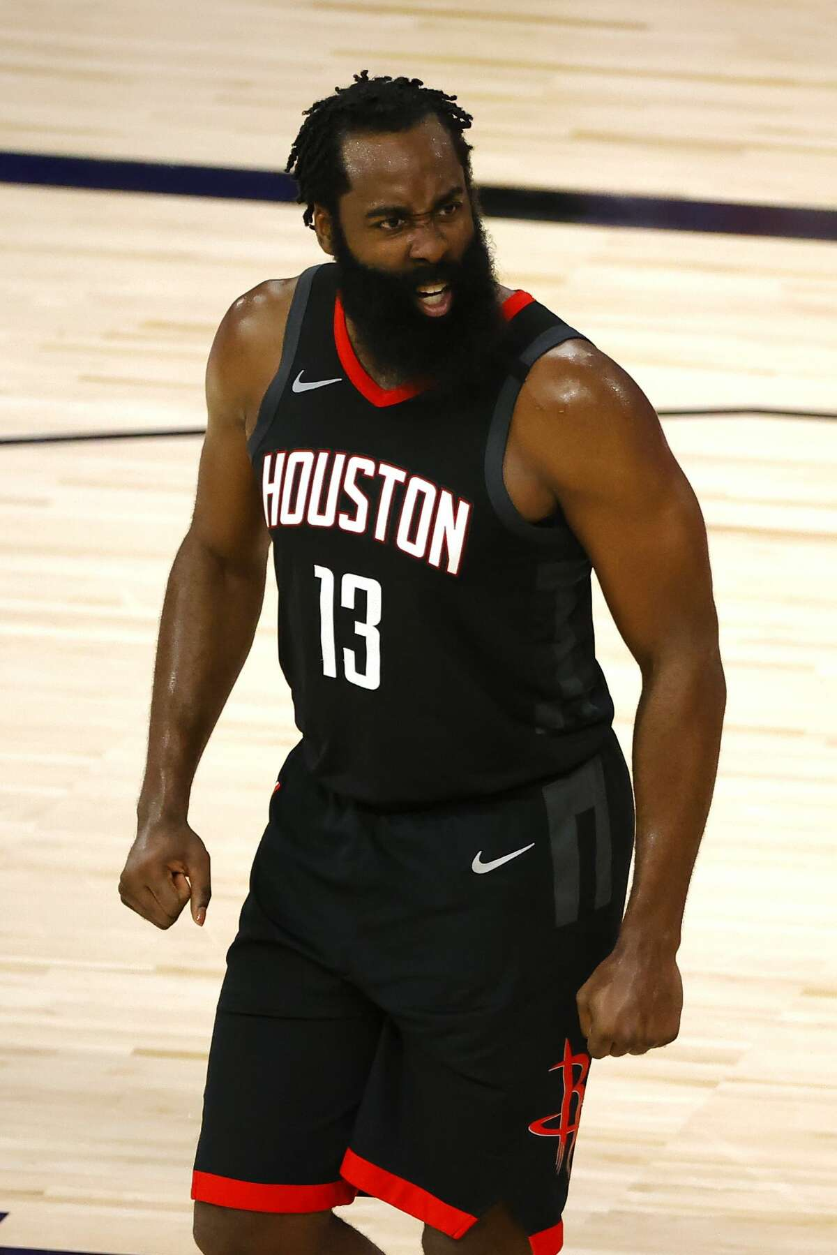 LAKE BUENA VISTA, FLORIDA - AUGUST 29: James Harden #13 of the Houston Rockets reacts against the Oklahoma City Thunder during the third quarter in Game Five of the Western Conference First Round during the 2020 NBA Playoffs at the Field House at ESPN Wide World Of Sports Complex on August 29, 2020 in Lake Buena Vista, Florida. NOTE TO USER: User expressly acknowledges and agrees that, by downloading and or using this photograph, User is consenting to the terms and conditions of the Getty Images License Agreement. (Photo by Kevin C. Cox/Getty Images)