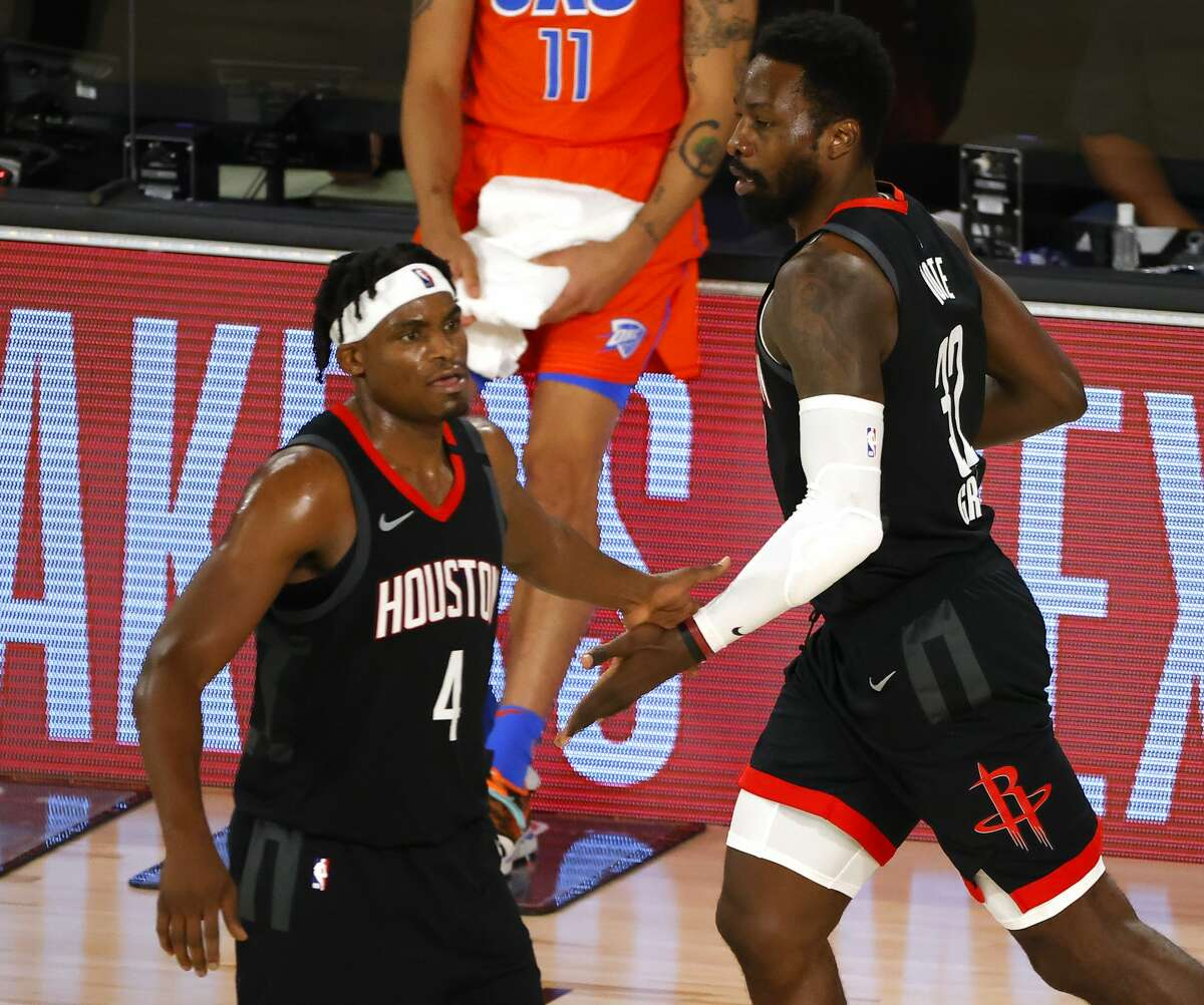 LAKE BUENA VISTA, FLORIDA - AUGUST 29: Jeff Green #32 of the Houston Rockets reacts with Danuel House Jr. #4 after hitting a three point shot against the Oklahoma City Thunder during the third quarter in Game Five of the Western Conference First Round during the 2020 NBA Playoffs at the Field House at ESPN Wide World Of Sports Complex on August 29, 2020 in Lake Buena Vista, Florida. NOTE TO USER: User expressly acknowledges and agrees that, by downloading and or using this photograph, User is consenting to the terms and conditions of the Getty Images License Agreement. (Photo by Kevin C. Cox/Getty Images)
