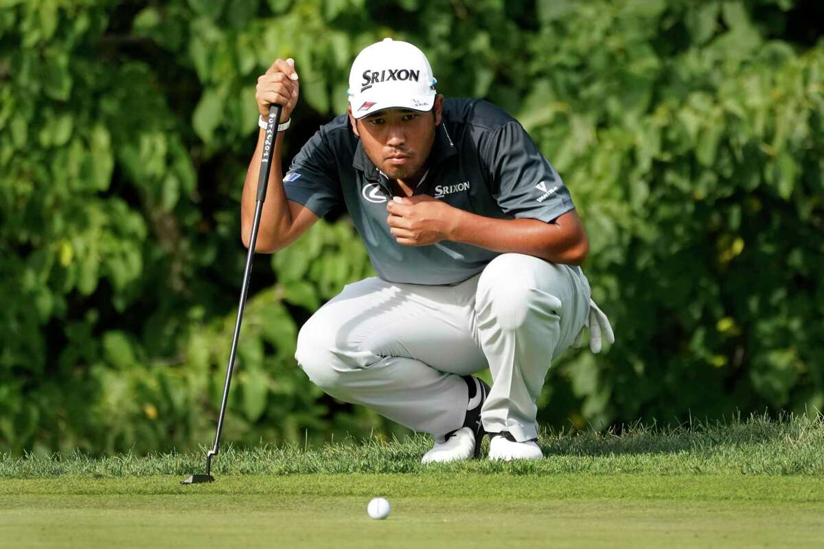 Hideki Matsuyama, of Japan, looks over the line before a birdie putt on the 16th green during the third round of the BMW Championship golf tournament Saturday, Aug. 29, 2020, at Olympia Fields Country Club in Olympia Fields, Ill. Matsuyama and Dustin Johnson are tied for the lead. (AP Photo/Charles Rex Arbogast)