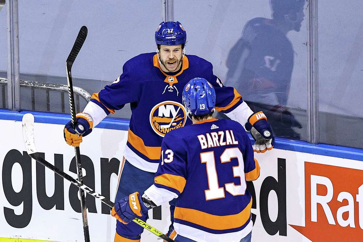 TORONTO, ONTARIO - AUGUST 29: Matt Martin #17 of the New York Islanders is congratulated by his teammate, Mathew Barzal, after scoring a goal against the Philadelphia Flyers during the second period in Game Three of the Eastern Conference Second Round during the 2020 NHL Stanley Cup Playoffs at Scotiabank Arena on August 29, 2020 in Toronto, Ontario. (Photo by Elsa/Getty Images)