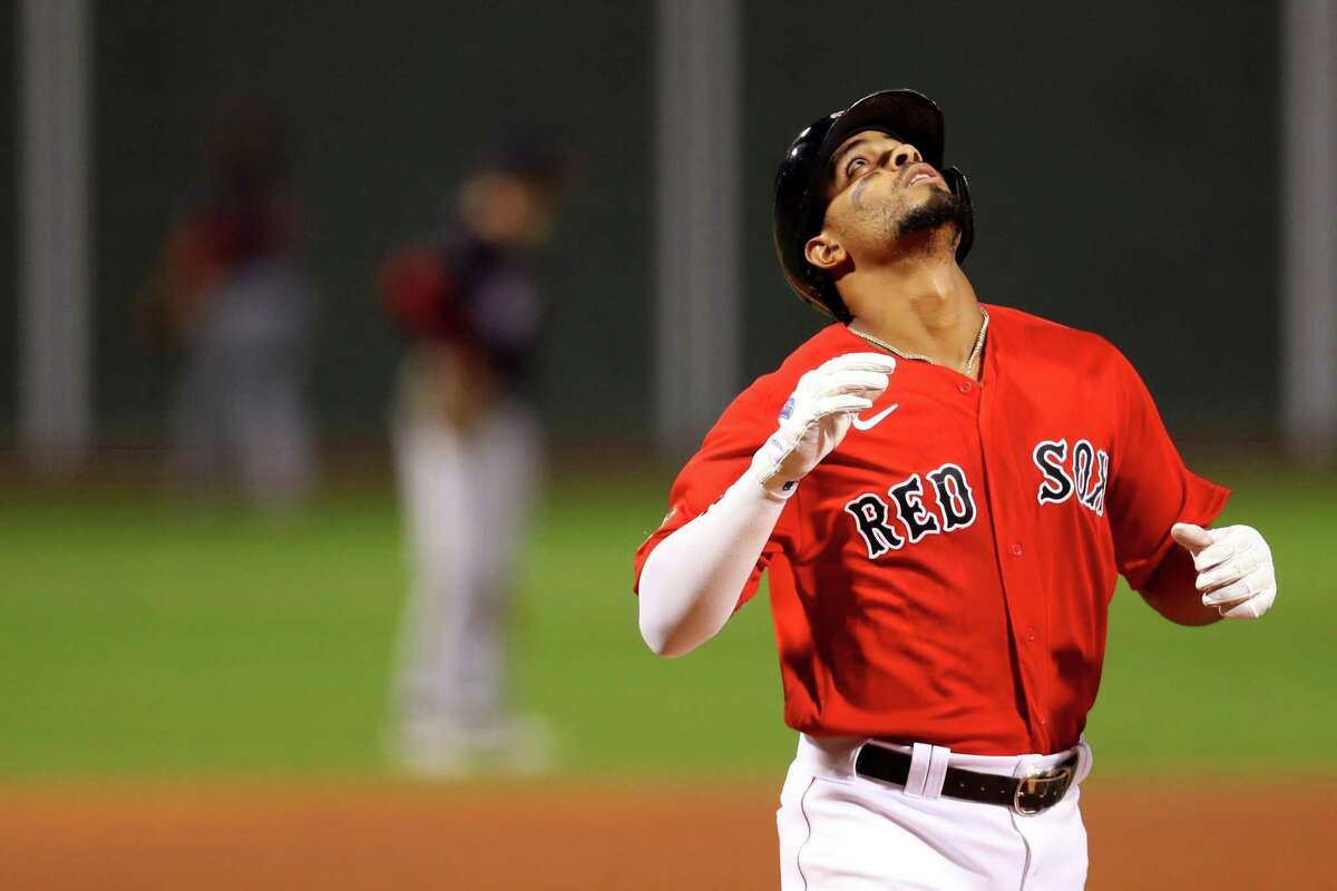 BOSTON, MASSACHUSETTS - AUGUST 29: Xander Bogaerts #42 of the Boston Red Sox celebrates after hitting a three run home run against the Washington Nationals during the first inning at Fenway Park on August 29, 2020 in Boston, Massachusetts. All players are wearing #42 in honor of Jackie Robinson Day. The day honoring Jackie Robinson, traditionally held on April 15, was rescheduled due to the COVID-19 pandemic. (Photo by Maddie Meyer/Getty Images)