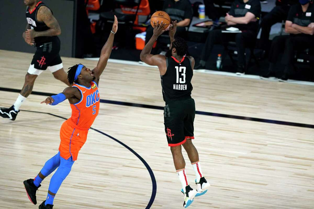 Houston Rockets' James Harden (13) shoots as Oklahoma City Thunder's Luguentz Dort (5) defends during the first half of an NBA basketball first round playoff game Saturday, Aug. 29, 2020, in Lake Buena Vista, Fla. (AP Photo/Ashley Landis)