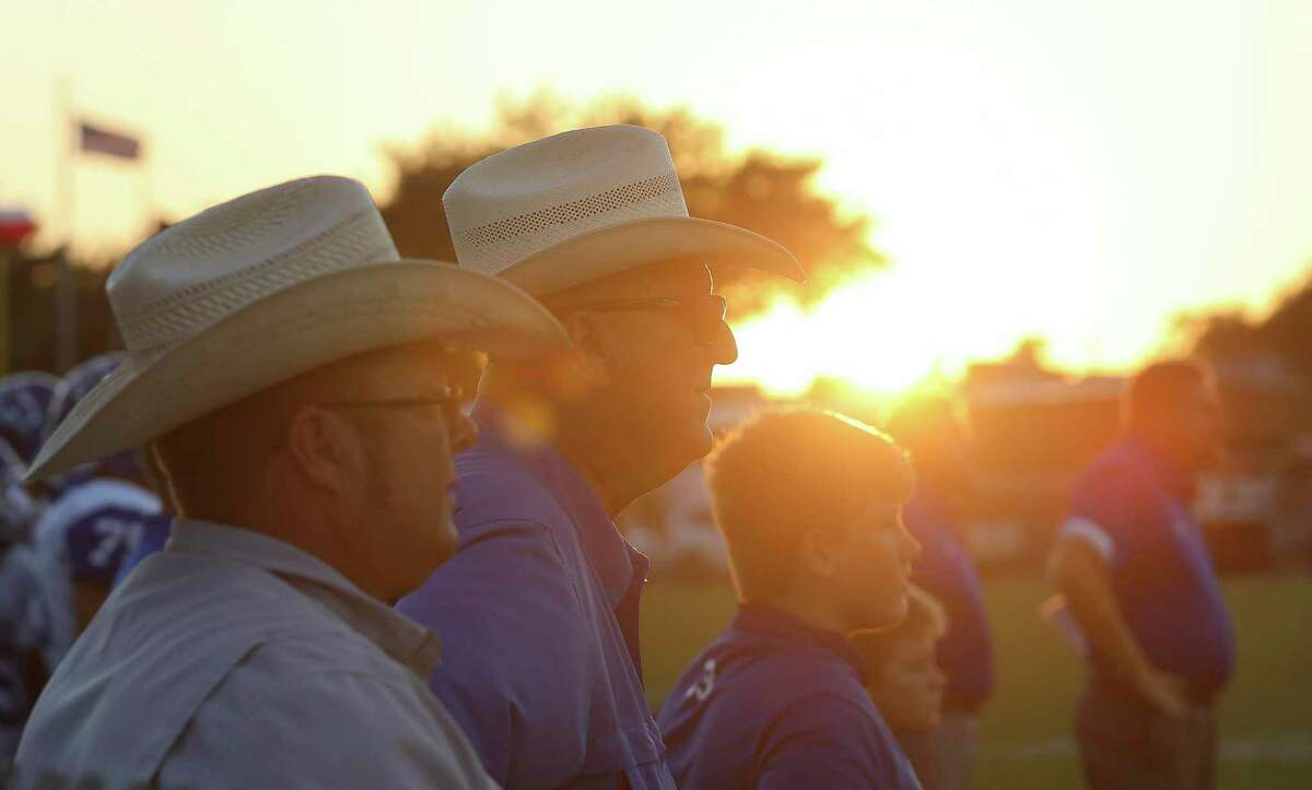 Traveling Edna High School football personnel watch the team playing against host East Bernard Friday, Aug. 28, 2020, at East Bernard High School Stadium in East Bernard. The East Bernard Brahmas defeated the Edna Cowboys 49-20 for the first game of the year.