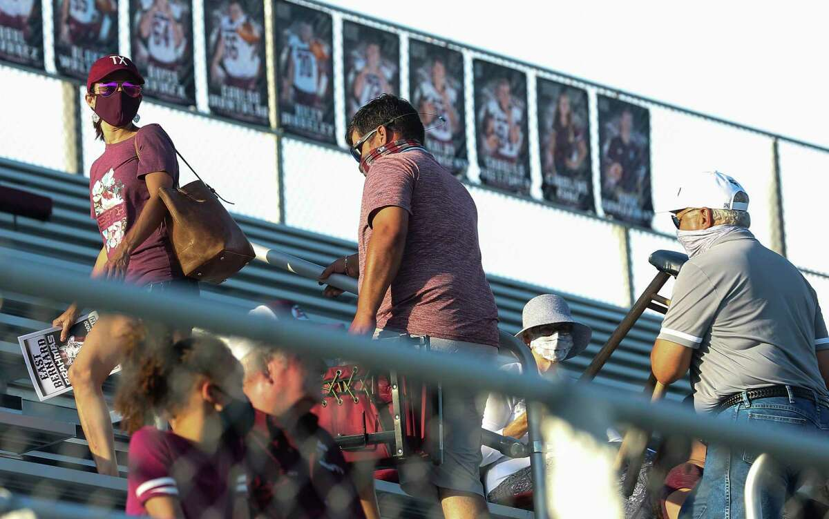 East Bernard fans looking for seats before the team takes on Edna for the first game of the football season Friday, Aug. 28, 2020, at East Bernard High School Stadium in East Bernard. The East Bernard Brahmas defeated the Edna Cowboys 49-20.