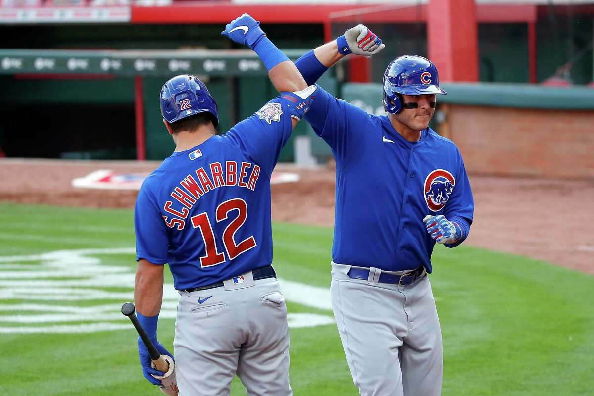 CINCINNATI, OH - AUGUST 29: Anthony Rizzo #44 of the Chicago Cubs is congratulated by Kyle Schwarber #12 after hitting a solo home run during the sixth inning of the game against the Cincinnati Reds at Great American Ball Park on August 29, 2020 in Cincinnati, Ohio. (Photo by Kirk Irwin/Getty Images)