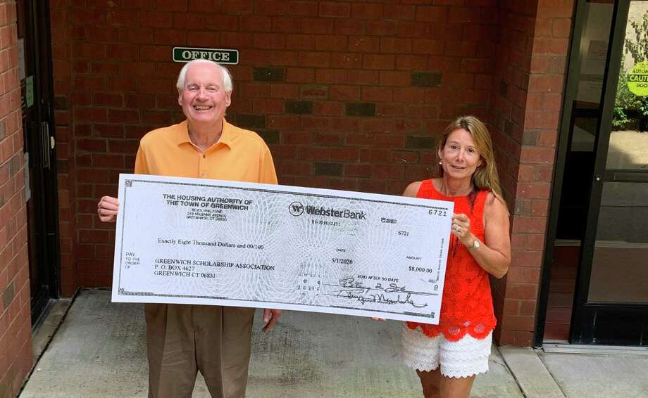 From left, Terry Mardula, deputy director and COO, and Andee March, a social worker, show off the scholarship funds. Both are with the Housing Authority of the Town of Greenwich. Photo: Contributed / Housing Authority Of Greenwich /