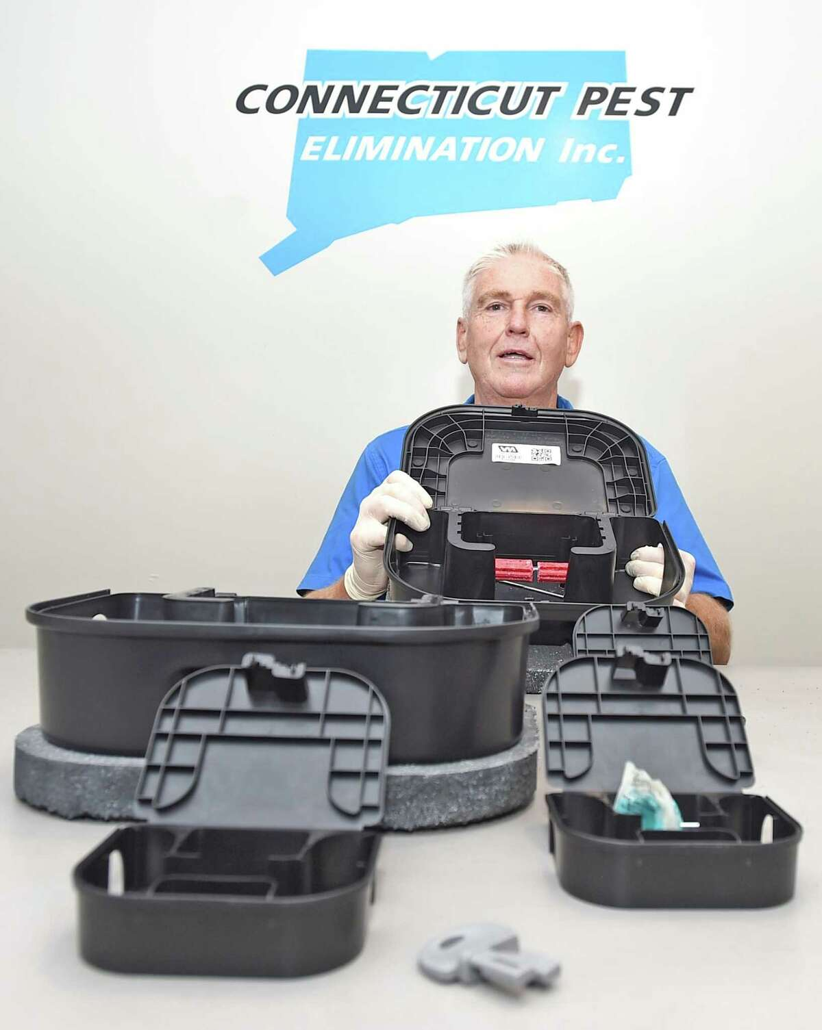 Orange, Connecticut - Saturday, August 29, 2020: Michael J. Lipsett, President of Connecticut Pest Elimination Inc. of Orange with exterior weighted mice and rat tamper resistant bait stations and interior mice bait boxes. The boxes hold skewered anti-coagulant rodenticide.