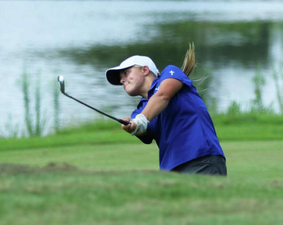 Marquette Catholic's Audrey Cain, watching her shot to the green on hole No. 18 in Tuesday's Metro East Shootout at Far Oaks in Caseyville, came back Saturday at the Illinois Challenge to shoot a season-best 77 at Sunset Hills Country Club in Edwardsville. Photo: Greg Shashack / The Telegraph