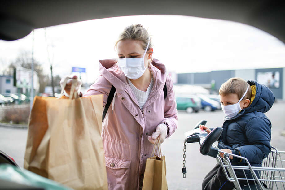 State directives require the use of face masks in public settings, such as stores. Photo: Halfpoint Images