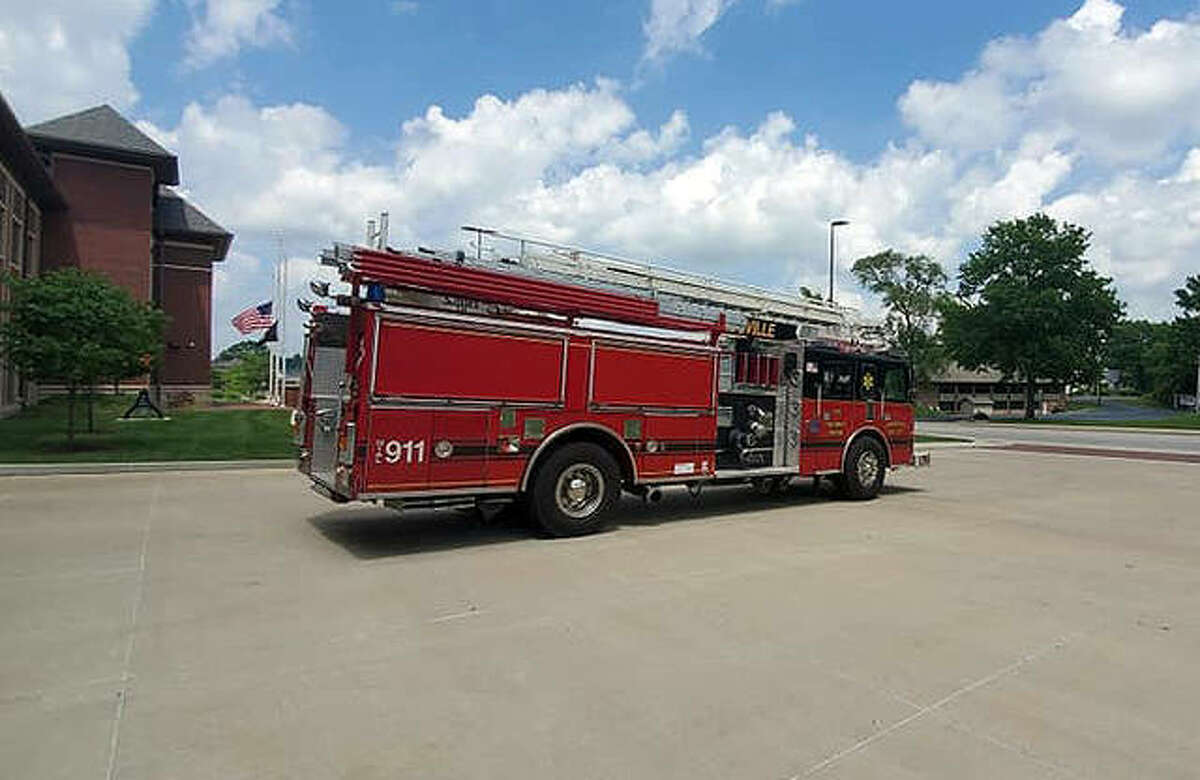 FILE - Engine 1318 bids good-bye to Fire Station 1 on S. Main Street before it heads to Witt, Illinois to begin its new service life for the volunteer fire department there.