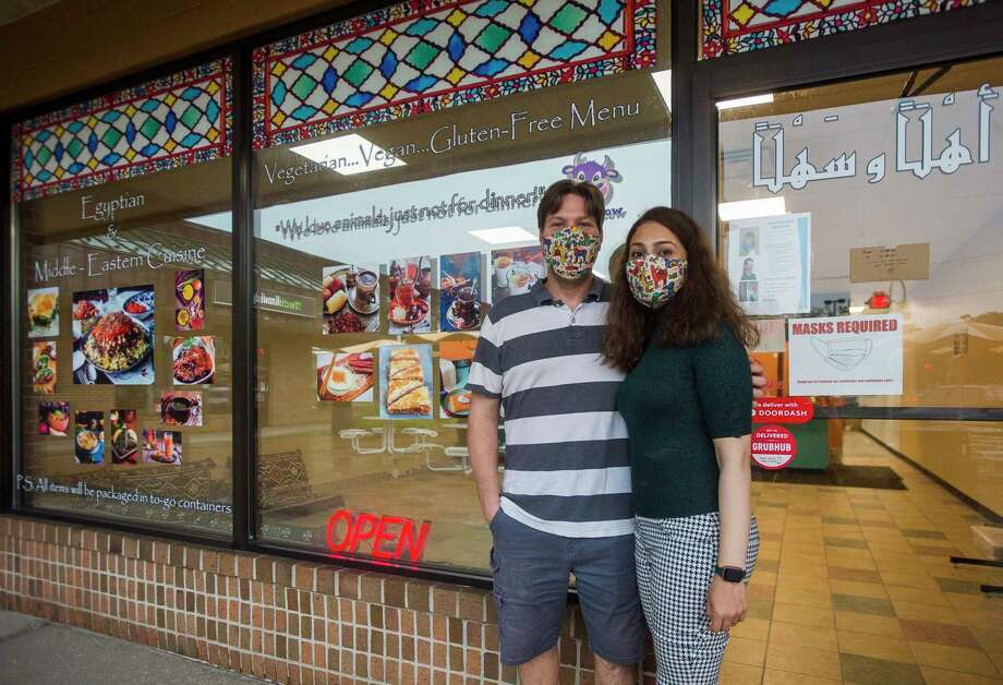 Dale Erdman, left, and Riham Erdman, right, pose for a portrait Thursday in front of their new restaurant, called Egyptian Koshery, located in the Eastlawn Plaza in Midland. (Katy Kildee/kkildee@mdn.net)