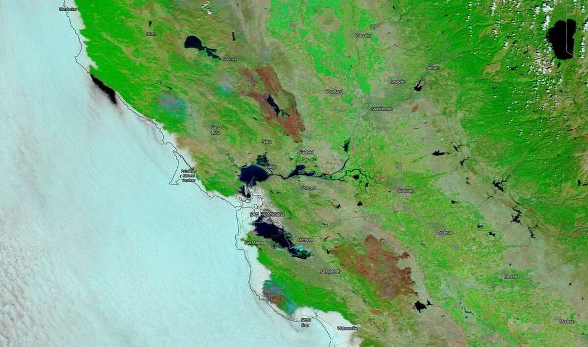NASA's Terra satellite captures this image of the burn scars from both the LNU Lightning fire complex and the SCU Lightning fire complex in California on Aug. 26, 2020.
