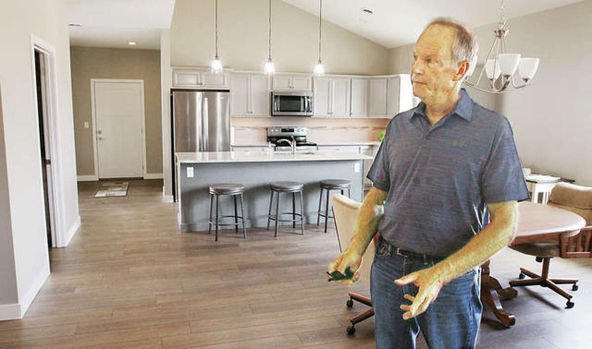 """Developer P.J. Jun, shown in a recently completed display home, is working on a project of five three-bedroom, access-enhanced homes called """"The Cottages at Davis Pond"""" in Godfrey."""