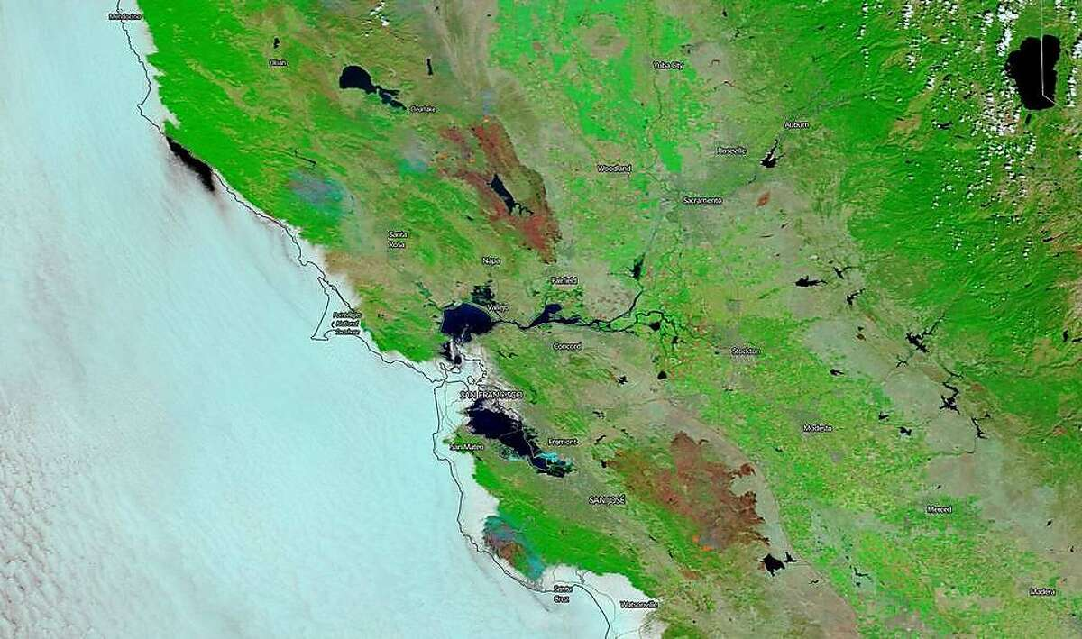 NASA's Terra satellite captured this image of the burn scars from both the LNU Lightning Complex and SCU Lightning Complex wildfires in Northern California on Aug. 26, 2020.