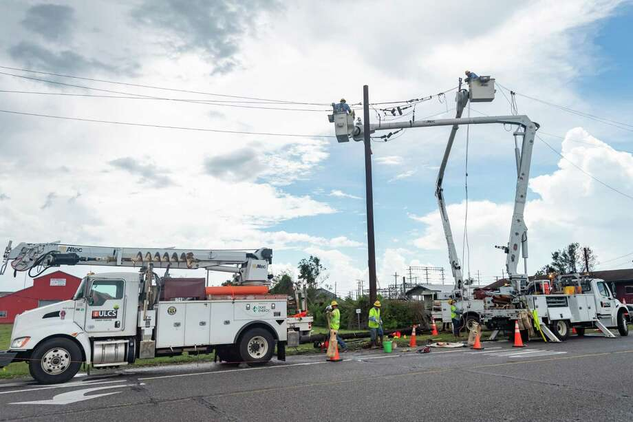 Electrical linemen at W. Green Avenue and Simmons Drive in Orange work to restore power to local residents. On Friday, the work of recovering from Hurricane Laura continued for many folks, some of whom had evacuated to avoid the storm. Photo made on August 28, 2020. Fran Ruchalski/The Enterprise Photo: Fran Ruchalski, The Enterprise / The Enterprise / © 2020 The Beaumont Enterprise