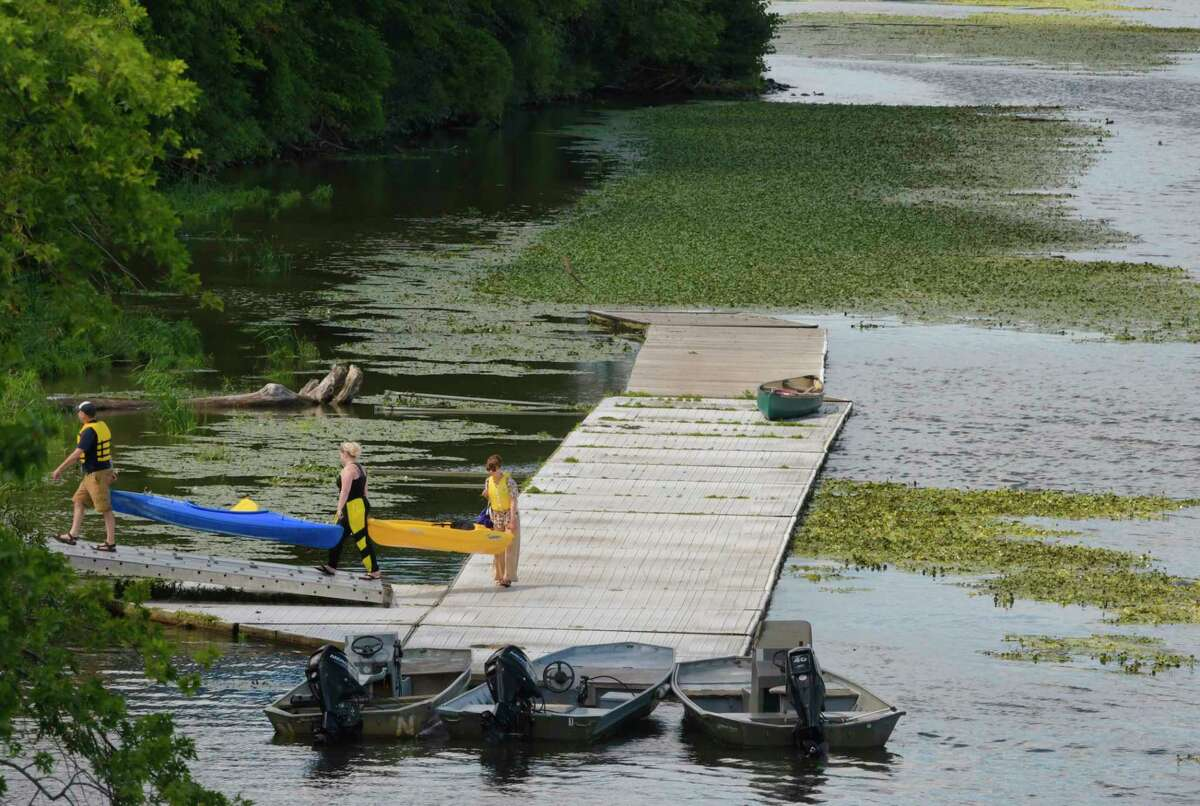 People carry their kayaks off the boat dock on the Mohawk River in Schenectady, N.Y. (Paul Buckowski/Times Union)