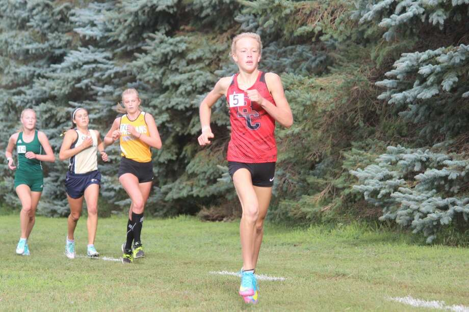Benzie Central's girls cross country team races at the Moss Invitational on Aug. 29. Photo: Robert Myers