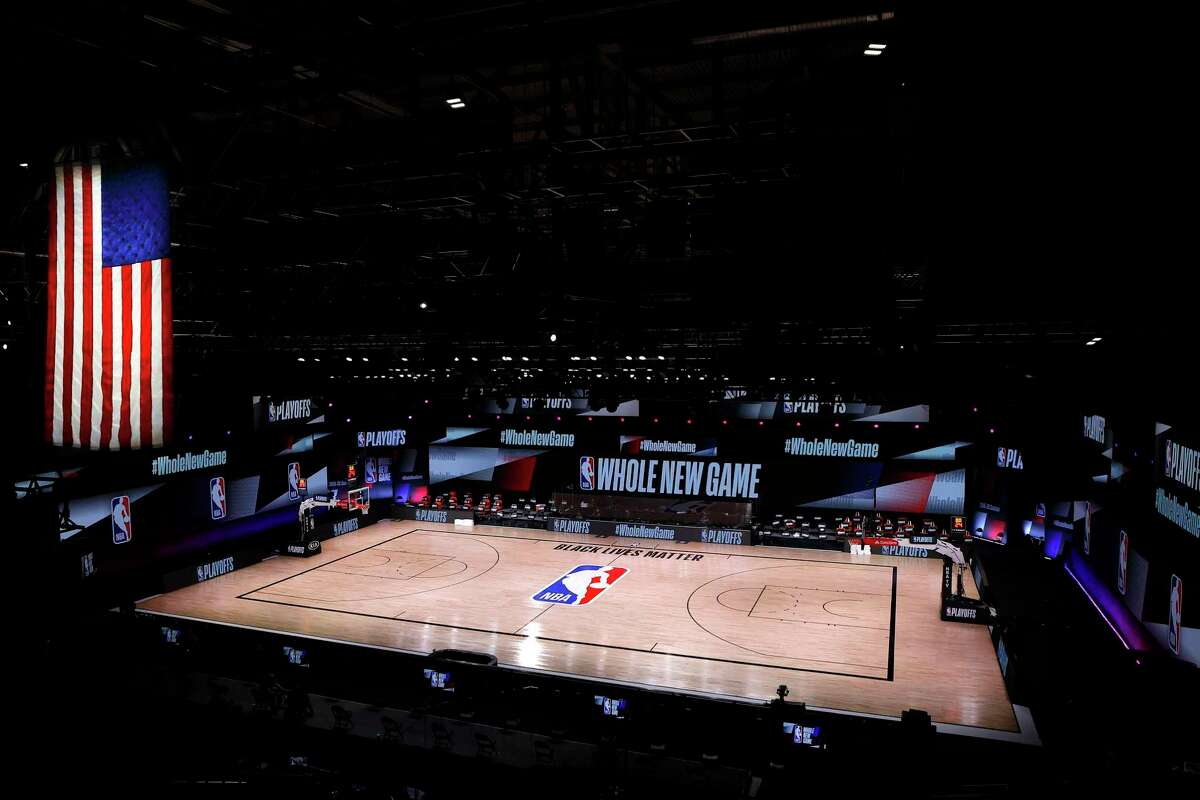 An empty court and bench is shown following the scheduled start time for a game between the Milwaukee Bucks and Orlando Magic on Aug. 26. The teams boycotted the game to protest the shooting of Jacob Blake in Kenosha, Wisconsin.