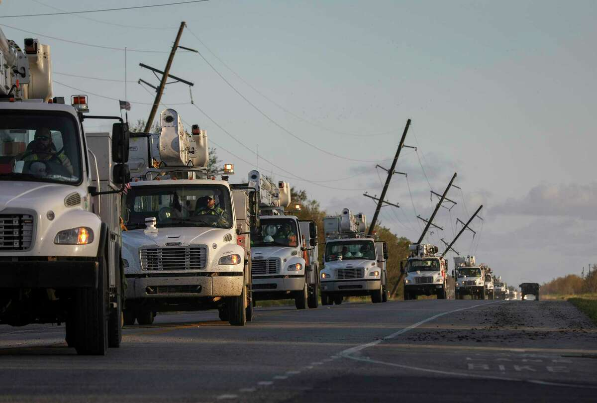 Utility crews pass a national guard humvee while driving north on State Highway 27 on Saturday, Aug. 29, 2020, in Cameron Parish near Grand Lake, La. Hurricane Laura made landfall near Cameron early Thursday morning.