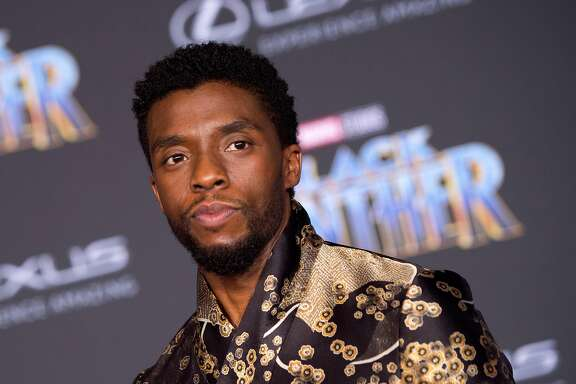 """(FILES) In this file photo taken on January 29, 2018 Actor Chadwick Boseman attends the world premiere of Marvel Studios """"Black Panther,"""" in Hollywood. - August 28, 2020 Chadwick Boseman died of cancer, he was 43. (Photo by VALERIE MACON / AFP) (Photo by VALERIE MACON/AFP via Getty Images)"""