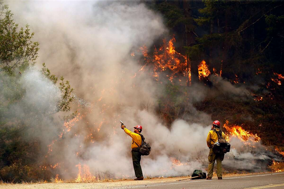 A US Forest Service firefighter shoots a fire igniter during firing operation along Limantour Road while Woodward Fire burns in Point Reyes National Seashore in Marin County in California on Sunday, August 30, 2020.